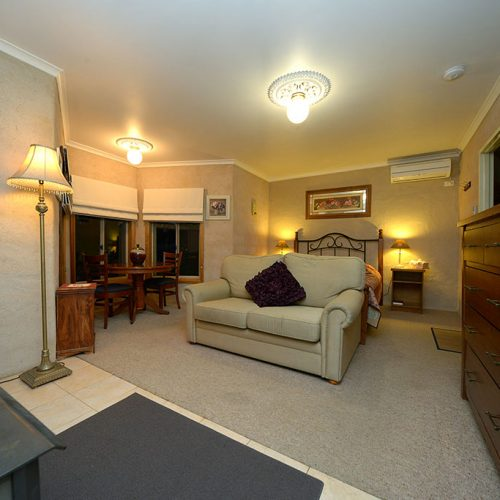Rose Cottage - Relax in the cozy lounge with romantic wood fire-place